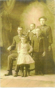 Lester and Pearl with oldest son Carl, little Ernest and Ella May