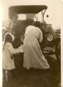 Lorene standing by while mom Blanche cranks up the old Model T