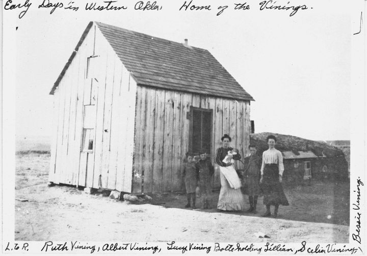 The sod house with a frame house attached.