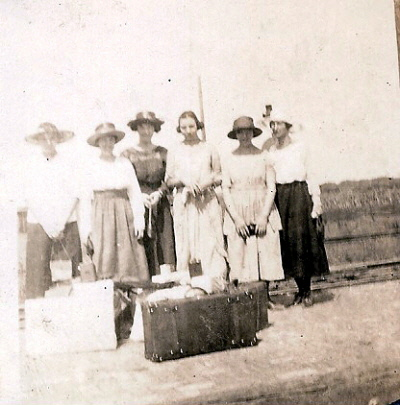 "The back of the photo says ""arriving in Baldwin, 1st time"" She worked for her room at Miss Bennet's place. I think Bertha is the young woman with a pole behind her."