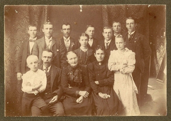Fred, Lester. Aaron, George, Harry, cousin Ralph and son Earl (top row) Elnora and Irene (center) Lawrence, James Jr., Sara Jane McFall Lindsley (Jane's mother) and Jane (affectionately known as grandma Jennie)