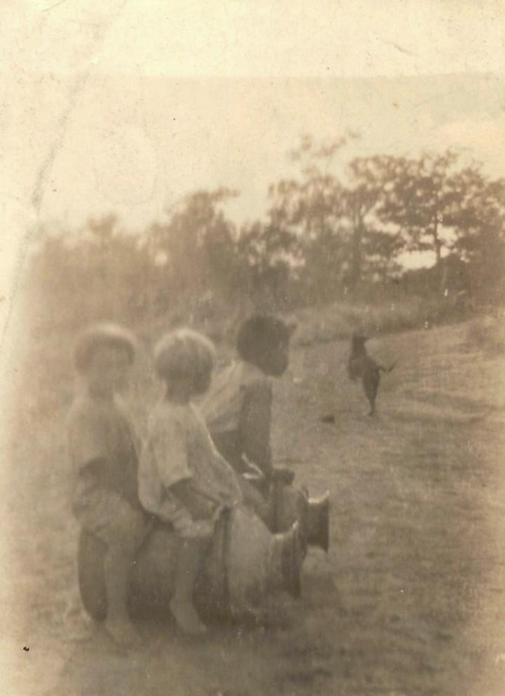 children and milk barrels